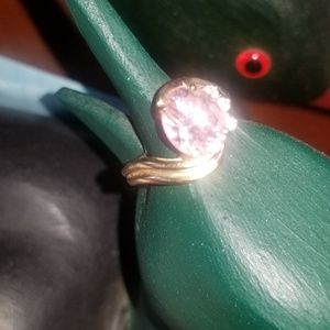 Pink stone with three diamonds.  14kt gold